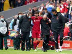 An injury to Andy Robertson leaves manager Jurgen Klopp sweating on the fitness of his left-back for next weekend's Premier League opener at Norwich (Nick Potts/PA)