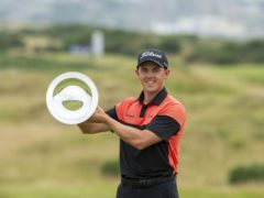 Grant Forrest holds the trophy on the 18th after winning the Hero Open at Fairmont St Andrews (Ian Rutherford/PA)