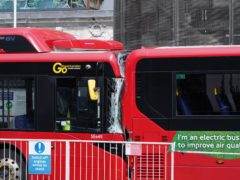 One woman was killed and three people were injured when a bus crashed into the back of another outside a major railway station (One woman was killed and three people were injured when a bus crashed into the back of another outside a major railway station/PA)