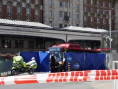 Police at the scene of the crash at Victoria bus station, central London (Ian West/PA)