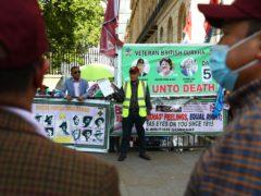 Gurkha veterans are protesting opposite Downing Street (PA)