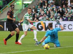 Celtic's David Turnbull strokes home the opener (Jeff Holmes/PA)
