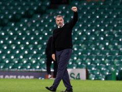 Ange Postecoglou gestures to fans after the game (Jeff Holmes/PA)