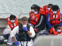 A group of people thought to be migrants are brought in to Dover, Kent, on a Border Force vessel (Steve Parsons/PA)