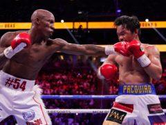 Yordenis Ugas, of Cuba, hits Manny Pacquiao (John Locher/AP)