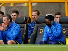 Tottenham Hotspur's Harry Kane (centre) sits on the bench (David Davies/PA)