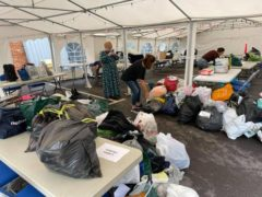 Donations being sorted in the car park of the Bushey United Synagogue (Bushey United Synagogue)