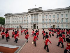 Members of the Nijmegen Company Grenadier Guards and the 1st Battalion the Coldstream Guards take part in the Changing the Guard at Buckingham Palace (Yui Mok/PA)
