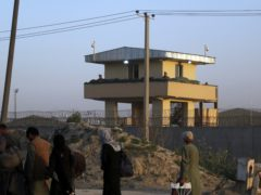 US soldiers stand guard at the airport tower near an evacuation control checkpoint during ongoing evacuations at Hamid Karzai International Airport, in Kabul, Afghanistan (AP)