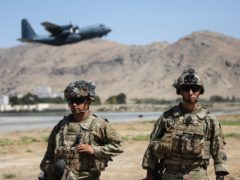 Two paratroopers of the 82nd Airborne Division stand guard outside Kabul airport as a plane departs (Department of Defence via AP)