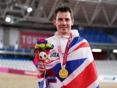 Great Britain's Jaco van Gass celebrates with his gold medal (Tim Goode/PA)