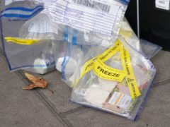 Evidence bags marked as a health hazard and containing produce outside the Tesco Express store on Fulham Palace Road, west London (Jonathan Brady/PA)
