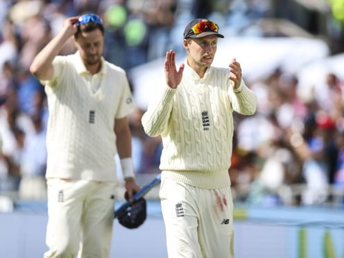England's Joe Root (right) claps the fans at Headingley after victory over India in the third Test with man-of-the-match Ollie Robinson alongside him (Nigel French/PA Images).