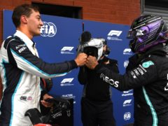George Russell fist bumps with Lewis Hamilton after finishing second in qualifying for the Belgian Grand Prix (John Thys/AP).