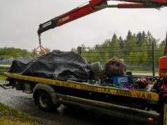 Lando Norris' car is taken away on the back of a truck (Francisco Seco/AP)
