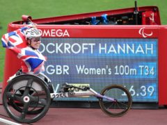 Great Britain's Hannah Cockroft poses with the scoreboard showing her new world record time (Tim Goode/PA)