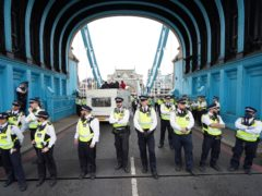 Police on Tower Bridge after members of Extinction Rebellion blocked the road (PA)