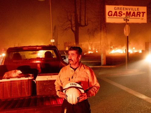 Battalion Chief Sergio Mora watches as the Dixie Fire tears through the Greenville community of Plumas County (Noah Berger/AP)