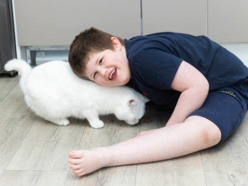Connor Raven, aged six, and his cat Minty (Fabio De Paola/Cats Protection)