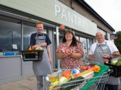 Mandy Morgan (centre) of the Scottish Pantry Network is calling for urgent action on obesity (Cancer Research UK/PA)