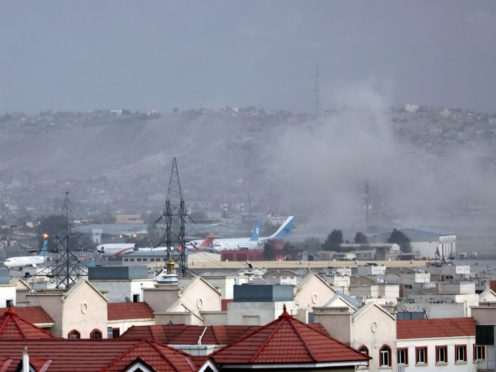 Smoke rises from explosion outside the airport in Kabul, Afghanistan (Wali Sabawoon/AP)