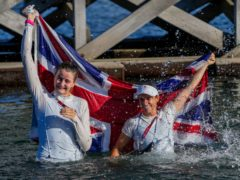 Great Britain's Hannah Mills, right, and Eilidh Mcintyre celebrate after winning gold (AP Photo/Bernat Armangue)