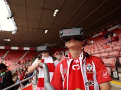 Florence and Joshua wearing IrisVision glasses at a Southampton game (Virgin Media/PA)