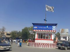A Taliban flag flies in the main square of Kunduz city after fighting between Taliban and Afghan security forces (Abdullah Sahil/AP)