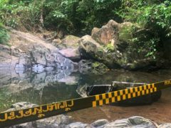Police tape cordons off the area where a woman was found dead on Phuket, Thailand (AP)