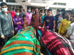 People gather around bodies of victims after lightning killed more than a dozen people in Bangladesh (Md Jahangir Alom/AP)