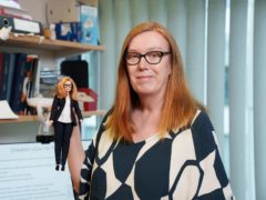Professor Dame Sarah Gilbert holding her barbie doll (Deft Productions/PA)