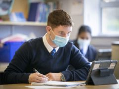 Face masks will continue to be required in secondary schools in Scotland when classes return later this month (Jane Barlow/PA)