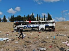 Officials investigate at the site of a bus crash in Balikesir, western Turkey (IHA/AP)