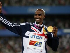Mo Farah celebrates his first world title after winning the men's 5,000 metres in Daegu in 2011 (Dave Thompson/PA)