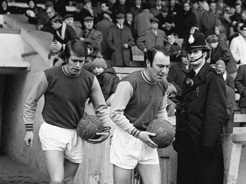 Geoff Hurst, left, has paid tribute to Jimmy Greaves following his death at the age of 81 (PA)