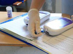 A nurse gives a patient a diabetes test (PA)