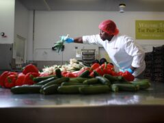 Prep chef Emanuel Coco at the COOK Kitchen in Sittingbourne, Kent, accredited as a Living Wage employer by The Living Wage Foundation (PA)
