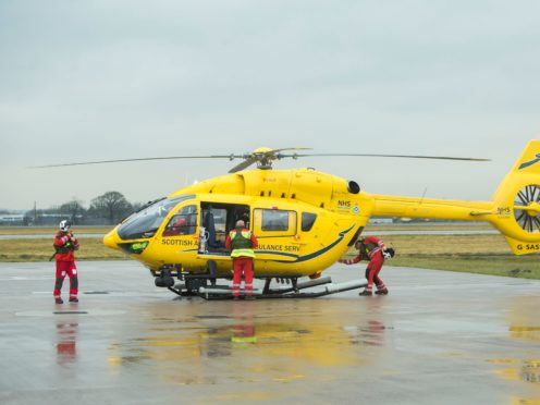 The woman was airlifted to hospital (Danny Lawson/PA)