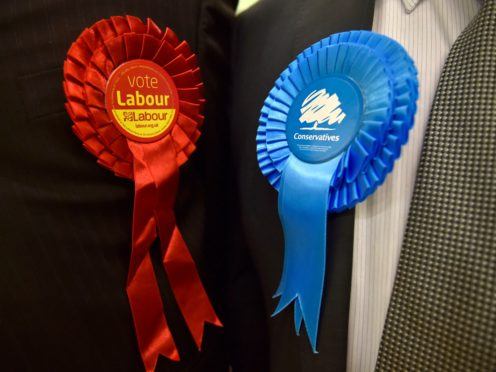 The councillors were suspended after going into coalition with the Conservatives (Hannah McKay/PA)