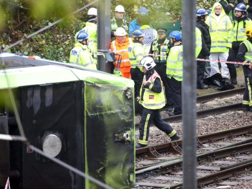 A coroner has urged the Government to consider fitting automatic brakes to trams after seven people were killed in a crash in Croydon, south London in 2016 (Steve Parsons/PA)