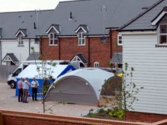 Police activity near a house at the centre of the Novichok attack (PA)
