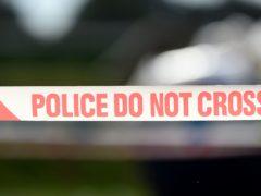 Police tape (Joe Giddens/PA)