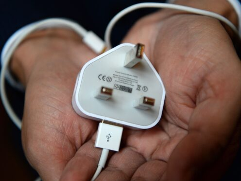 The move could be particularly problematic for Apple, which uses its own Lightning port for iPhones (Kirsty O'Connor/PA)