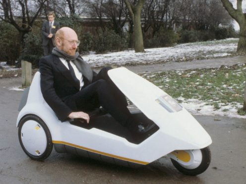 Sir Clive Sinclair demonstrating his C5 electric vehicle (PA)