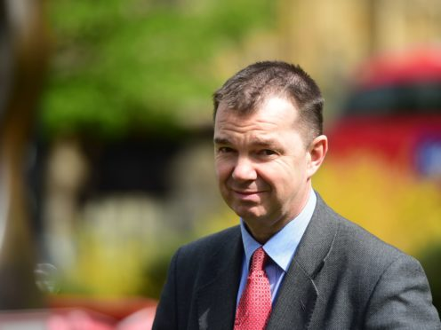 Work and pensions minister Guy Opperman (PA)