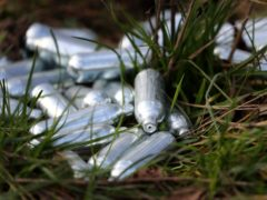 Canisters of laughing gas discarded by the side of a road near Ebbsfleet, Kent.(Gareth Fuller/PA)