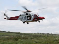 An HM Coastguard helicopter was involved in the rescue effort (Andrew Matthews/PA)