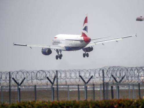 A British Airways plane lands in the strong winds at Heathrow airport,