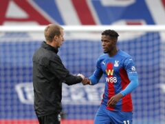 Brighton manager Graham Potter (left) is well aware of the threat posed by Crystal Palace's Wilfried Zaha (Adrian Dennis/PA)