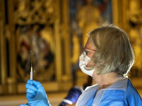 The Pfizer coronavirus vaccine is prepared by a health worker at Salisbury Cathedral, Wiltshire (Steve Parsons/PA)